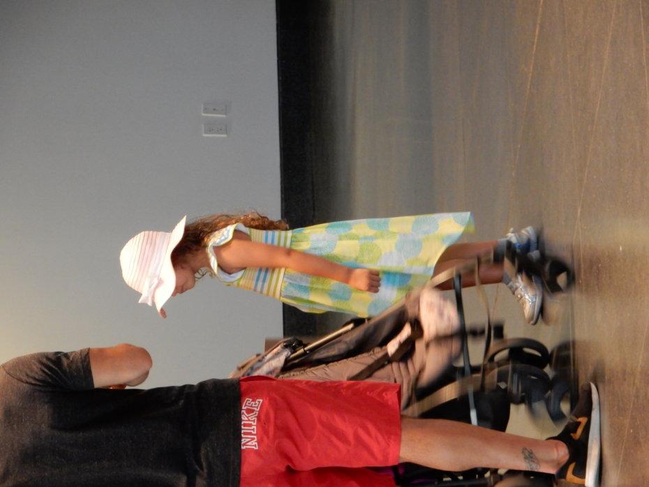 Little Girl Next to a Stroller