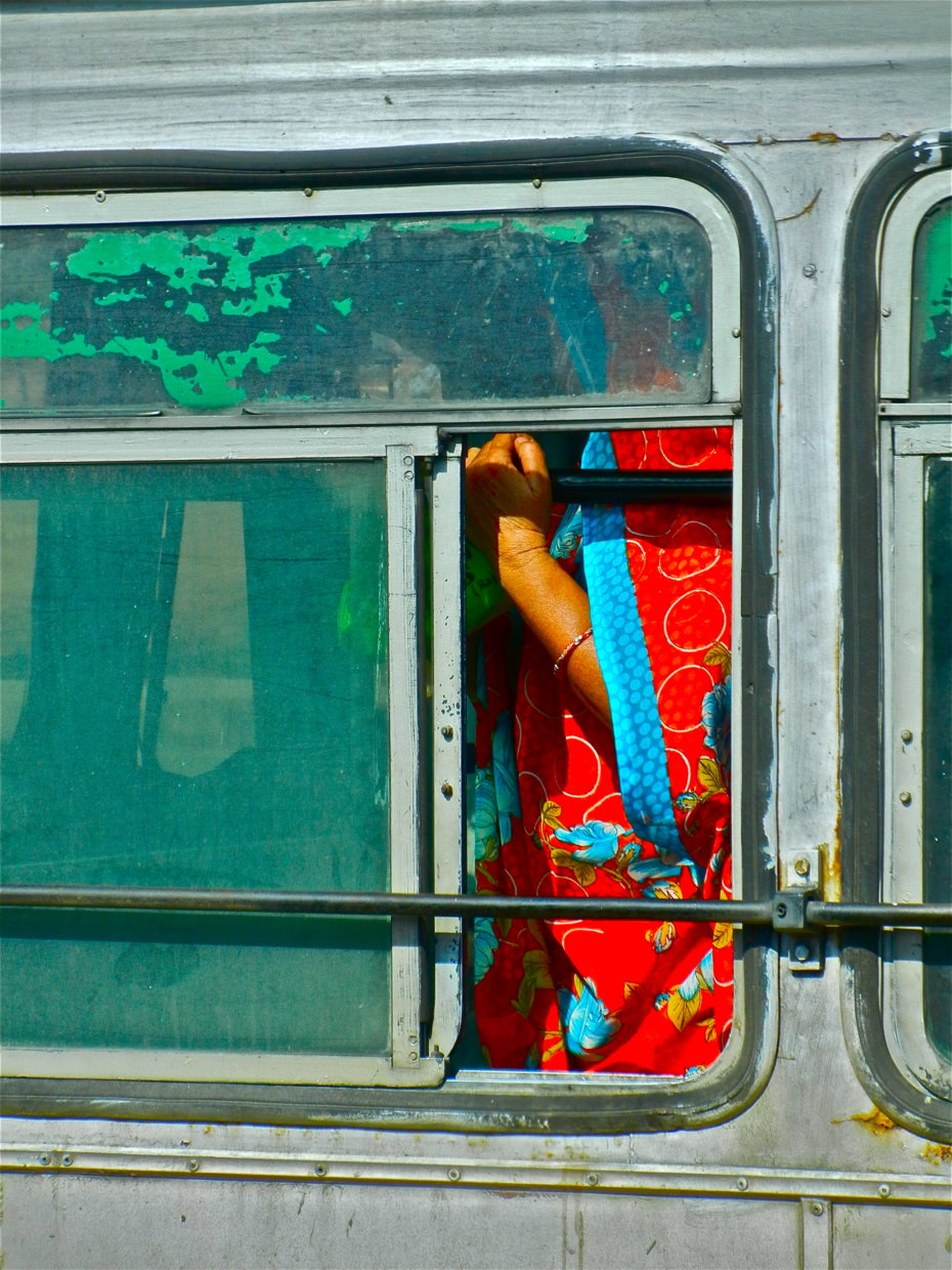 Woman Standing in a Bus