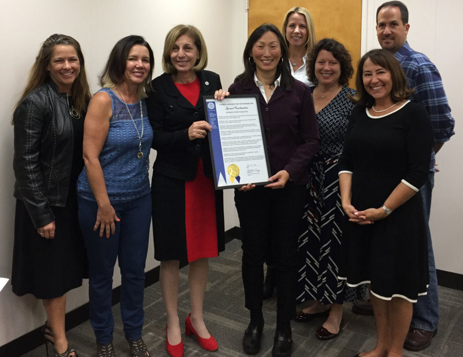 Council President Bry presents Workplace Gender Equity Day proclamation to Hei-ock Kim, along with members of the Councilmember's Workplace Equity Initiative