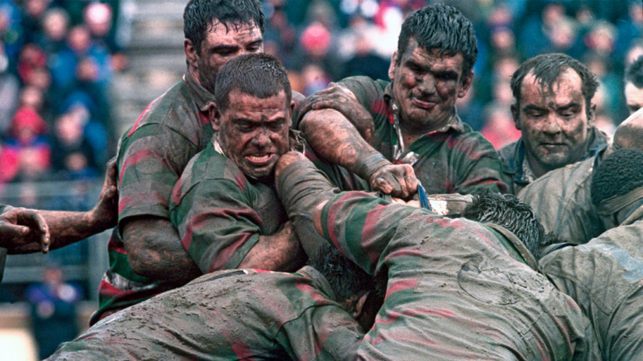 Men, Covered in Mud and Fighting