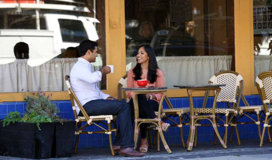 A Woman and Man Sitting at a Cafe, Talking to Each other