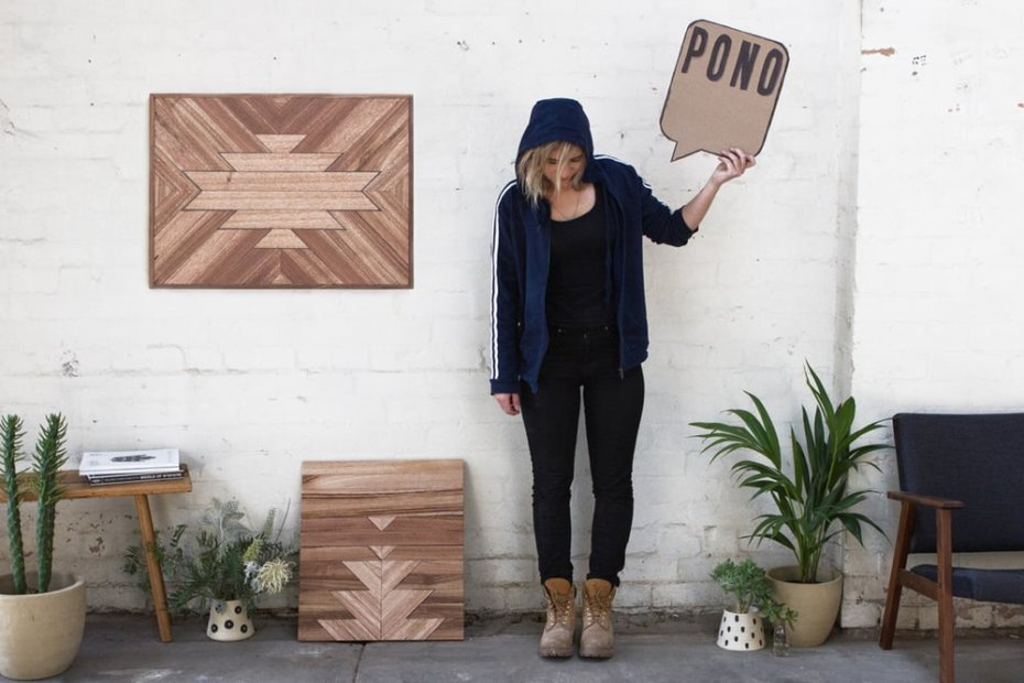 "Woman Standing with a Text Box Cutout Saying ""PONO"""