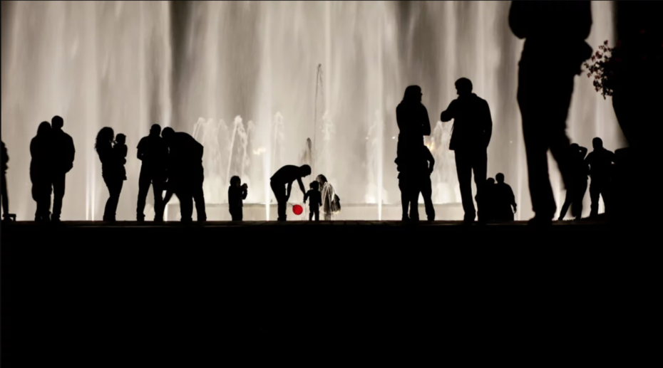 Silhouette of People In Front of a Fountain