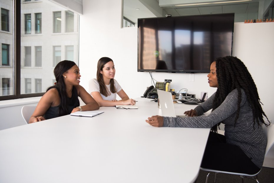Three Woman Talking in a Office Meeting Room